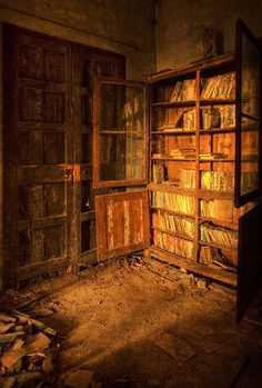 Incredible, mysterious places...Books decaying on shelves in an abandoned castle in Spain.