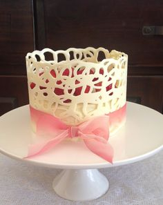 White chocolate lace collar, white chocolate mud cake  strawberries.