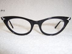 cats eye glasses.