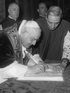"Pope John XXIII signs document ""Humanae salutis"" formally convoking the Second Vatican Council, December 25, 1961"