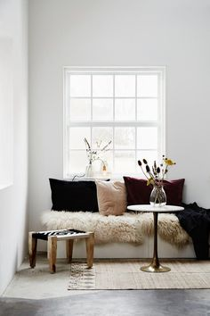 interior styling | cosy corner | sheepskins and pillows | scandinavian style