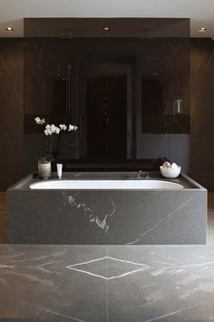 Beautiful use of smoked glass and book matched marble. A truly clean and simple design