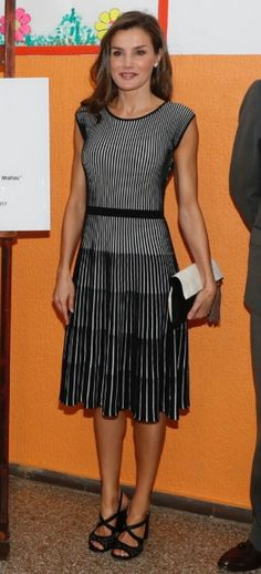 Queen Letizia - Flattering black and white Hugo Boss dress - Carolina Herrera sandals and clutch.