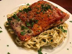Pam seared salmon with white white dijon sauce on top of aglio e olio pasta