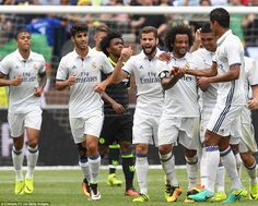 Real Madrid's players surround Marcelo after he opened the scoring against Chelsea at the Michigan Stadium in Ann Arbor.