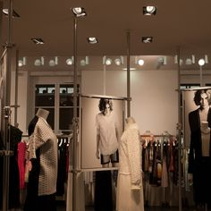 Colette - Autopole brings the space to life offering a simple and sophisticated option for displaying graphics and clothing in a women's fashion store.