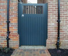 Painted solid gate with spindle top section