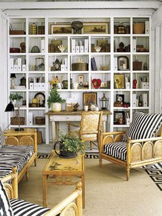Obsessed! Love the vintage, distressed wall of shelves!
