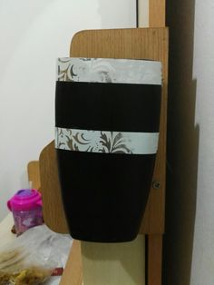 DIY PHONE HOLDER.: You will need An old shampoo bottle Washi tape Double sided tape  method: Cut open an old shampoo bottle and trim the edges Put some washi tape for decoration. On the back side put double sided tape strips and attach it on wherever nearest to plug point , n u can keep your phone whenever it's charging or just like a resting place .