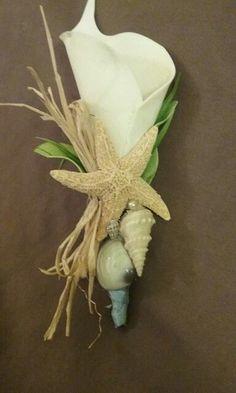 DIY beach wedding boutonnieres accessories. Silks, shells, ribbon raffia heavily hot glued to a pin.