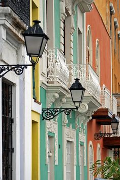 Old San Juan  Lamps and Balconies on brightly colored buildings. Old San Juan shopping district.  San Juan, Puerto Rico