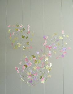 Butterflies on wire mobile, what a cute idea!