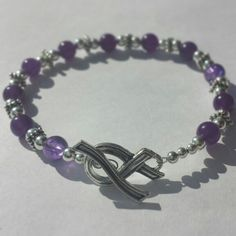 Domestic Violence Awareness Bracelet with Awareness Ribbon Clasp.  Part of the S…