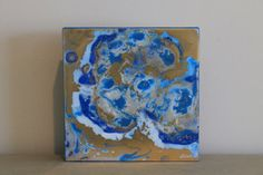 Pair of unique paintings created using epoxy resin to give a glossy, glass like finish that enhances the colors and provides a 3 dimensional effect. This colorful painting would make a vibrant additional in any space.  Colors - blue, cobalt, light blue and gold Dimensions - 10 inch by 810 inch Depth - 1 inches thick Material - Wooden panel, epoxy resin, acrylic, ink Side - finished with paint on sides  Signed on front of the painting.  *** Id be happy to make something similar or a pair or…