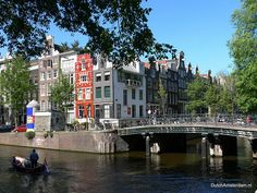 Houses lining the canals of Herengracht and Leliegracht in downtown Amsterdam.