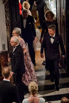 HM King Carl Gustaf of Sweden enters the Dome Hall and seen in the picture with Princess Benedikte and HRH the Crown Prince.