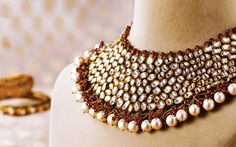 Ichha necklace- Elaborate kundan polka necklace with semi-precious stones and pearls in 22k gold.