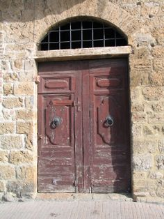 The Red Door.  It's a little worn, but that's what gives it charm.  San Gimignano, Italy.