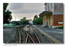 lithuanian village railway station, often there are no platforms just the railway. Do we need a station or just a track beside worn ground - worn by passengers feet?
