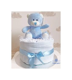 Are you looking for a Unique Gift for a Newborn Baby Boy? Or searching for that perfect Baby Shower Gift? Whether you want to take a special gift that's very unique and adorable to the hospital for meeting that little bundle of joy for the first time or for the first home visit this One Tier Diaper Cake/ Nappy Cake is perfect for these occasions. We creatively design these Diaper Cakes/Nappy Cakes using high quality baby clothing and Pampers Diapers/Nappies and they are guaran...