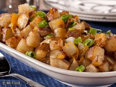 Cheesy Onion Potatoes | mrfood.com  These home-style potatoes topped with Cheddar cheese bring back memories of a restaurant specialty. A scrumptious side dish couldn't be any easier! Our recipe calls for unpeeled potatoes, which make this dish quick. Remember, though, there are no rules. So if you want to peel your potatoes, go for it!