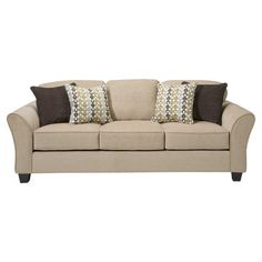 $352 Pairing a streamlined design and tan upholstery, this elegantly understated sofa makes a chic canvas for patterned pillows and a fringed throw.