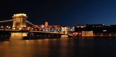 """Budapest by night - Chain bridge"" by Andor K, Budapest // Night picture of the iconic Chain bridge (Lánchíd) of Budapest. Castle of Buda in the background. // Imagekind.com -- Buy stunning, museum-quality fine art prints, framed prints, and canvas prints directly from independent working artists and photographers."