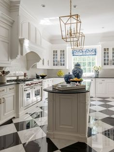 Glossy checkerboard floors get a contemporary update in this kitchen by designers Richard Ouellette and Maxime Vandal. White Kitchen Floor, New Kitchen, Kitchen Decor, Kitchen Black, Kitchen Ideas, Checkered Floor Kitchen, Warm Kitchen, Island Kitchen, Kitchen Sinks