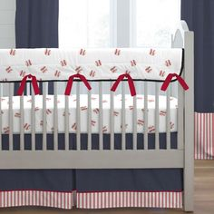 Red and Navy Baseball Crib Bedding by Carousel Designs.  Your nursery is sure to hit a home run with our adorable Red and Navy Baseball crib bedding collection. What little slugger wouldn't love this fun bedding! The classic colors of red and navy make it easy to coordinate with all of your favorite sports memorabilia.
