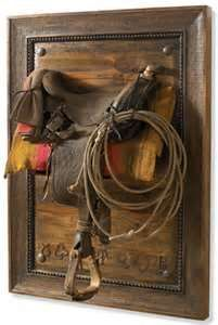 An old western saddle hanging on the wall horse decor rustic home decor guide home design and decor charming western home decor ideas playroom with western home decor Old Western Decor, Western Furniture, Rustic Furniture, Country Decor, Rustic Decor, Western Crafts, Handmade Furniture, Westerns, Southwest Decor