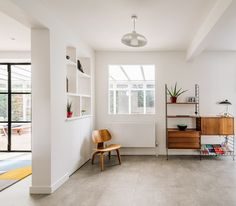 Mid-century themed renovation in Wanstead.  We joined up 2 houses into a single dwelling and remodelled the internal layout.  The ground floor now has a free layout.