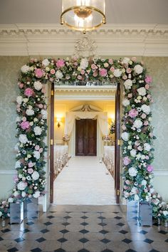 Rachel and Will's stunning wedding flowers were created by Lavender Green in Windsor. 'We had a gorgeous thick archway of flowers at the ent...