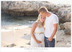 white dress couples maternity photos on beach