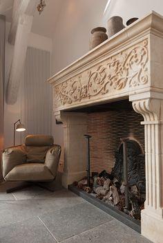 Belgian bluestone Grand antique de Bocq floor tiles with antique fireplace in living room