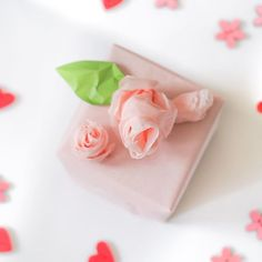 A little bit of pink tissue paper, an even smaller bit of green origami paper - et, voilà - easy roses and rosebuds for gifting good things in small packages!  #roses #rose #ValentinesDay #giftwrapping #diyproject #diyprojects #Valentines #diy #crafty #craft #crafting #diygiftwrapping #gifting #giftwrappingideas #love #valentine #Valentinesgift #Valentinesgifts #gift #gifts #pink #Valentines2016 #flower #flowers # #❤️ # #littlebirdieme #lbm