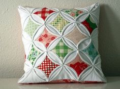 cathedral window pillow DIY ... http://warmthinthenorth.typepad.com/warmth_in_the_north/cathedral-window-pillow-tutorial-.html#