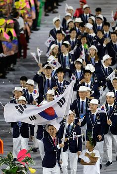 Gu Bon-gil carries the flag of South Korea during the opening ceremony for the 2016 Summer Olympics in Rio de Janeiro, Brazil, Friday, Aug. 5, 2016.