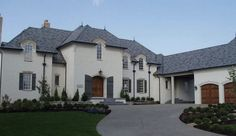New french inspired stucco home. Via Enchanted Home.