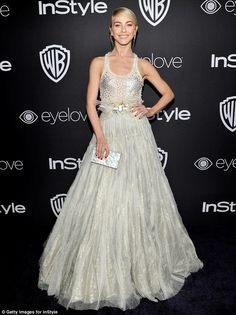 JUst a touch: Julianne Hough wore a hint of sparkle, donning a semi sheer white dress with...