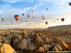 Hot air balloons drifting over what I think is Love Valley in Cappadocia