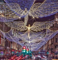 Christmas lights on Regents Street in the form of angels. Regents Street is the main shopping venue in London.