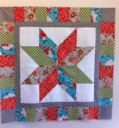 silver star quilt made with denyse schmidt and vintage modern/moda fabric..