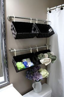 Baskets on towel rods for bathroom storage