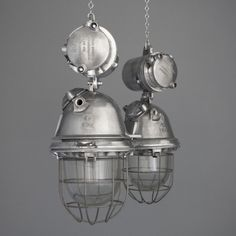 Beautifully engineered German explosion proof industrial lights salvaged from factories within the former Eastern Bloc. Circa 1960. Oversized polished aluminium enclosure featuring cast manufacturers marks and with original glass well and steel protection cage.