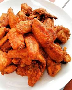 Chicken Buffalo Wings - A Buffalo wing, in the cuisine of the United States, is an unbreaded chicken wing section that is generally deep-fried then coated or dipped in a sauce consisting of a vinegar-based cayenne pepper hot sauce and melted butter prior to serving. Fried Chicken Wings, Buffalo Wings, Chicken Wing Recipes, Buffalo Chicken, Melted Butter, Hot Sauce, Vinegar, Fries, United States