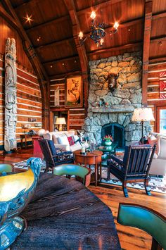 This post-and-beam home's traditional rustic architecture frames a collection of Western art and antiques and Native American artifacts.