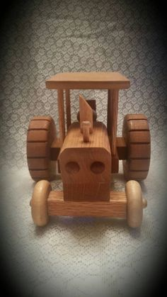 This Beautiful handcrafted toy tractor is made by my grandfather. Each piece is carefully put together to give it that realistic look. They are built to be sturdy to last generations, but please do be careful with them as the little pieces could break off if thrown.