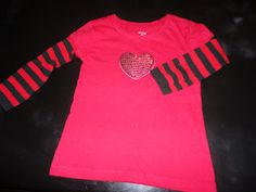 I sewed socks to a t-shirt to make a longsleeve Valentine's t-shirt.