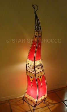 Tall Red Sahara Sun Beautifully hand-painted Moroccan henna Lamp. This lamp will accentuate any home decor with magic.   Dimensions: Height = 62 inches, Width = 12 inches.There is only one lamp left! All our lamps come wired and ready to use. Uses a 60-watt bulb or lower.