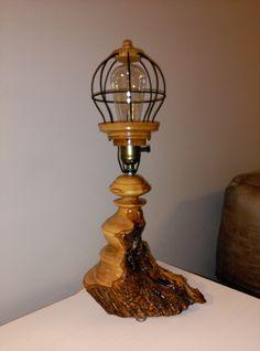Based on olive wood and tulip oak and wire. By Pakito Soriano. Lampara en madera de olivo. la tulipa realizada en roble con insertos de alambre. PAKITO SORIANO.